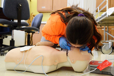Erica Miller @togianphotog - The Saratogian:   At the BOCES school on Henning Road in Saratoga Springs, Corinth Junior Tiffany Lucia, 17 years old, demonstrates adult CPR during the Skills USA competition.