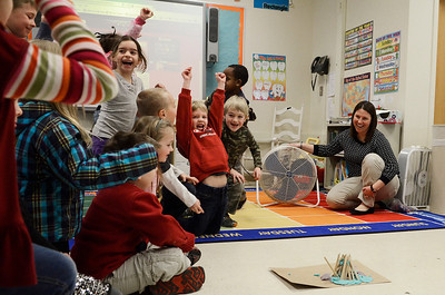 """Erica Miller @togianphotog - The Saratogian:  On Thursday morning, February 27th, 2014, kindergartners in Mrs. Allison Girard's classroom (maternity substitute teacher) at Lake Ave Elementary, students worked on building homes with play dough, sticks and glue. The class is the only pilot school in NYS for the pre-engineering program Project Lead the Way. The class read the """"three little pigs"""" and tried to build their own houses to test against a fan. Girard turned on the fan to test one groups house, as the students cheer in excitement."""
