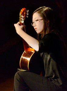 Ed Burke - The Saratogian 03/22/14 Shenedehowa 10th grader Tammy Jeon plays classical Spanish guitar Saturday at Shensational Global Expo 2014 at Shenendehowa West High School. The annual event celebrates the cultural diversity reflected in the local community.