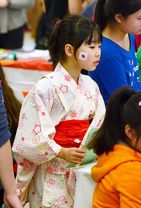 Ed Burke - The Saratogian 03/22/14 Wearing a beautiful kimono, Shatekon Elementary student Chiho Kakita displays her Japanese heritage Saturday during Shensational Global Expo 2014 at Shenendehowa West High School. The annual event celebrates the cultural diversity reflected in the local community.