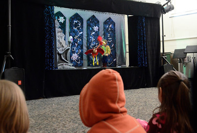 Ed Burke - The Saratogian 03/22/14 Children watch a puppet show Saturday during Shensational Global Expo 2014 at Shenendehowa West High School. The annual event celebrates the cultural diversity reflected in the local community.