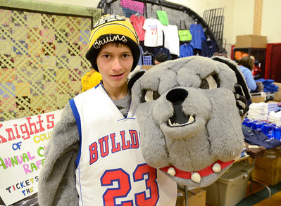 """Ed Burke - The Saratogian 03/07/14 Freshman Ben """"Bones"""" Kinne lets the dog out as South Glens Falls High School Bulldogs kick off their 24 hour Marathon Dance Friday night. Funds raised from the event, which began in 1977, wills be distributed between 39 needy individuals, families and organizations. Kinne has dressed as top dog since he was in 5th grade."""