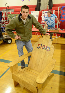 Ed Burke - The Saratogian 03/07/14 2011 South Glens Falls High School graduate Nick Heald stands with the Adirondack chair he's donating to the live auction Saturday at the South High Marathon Dance. Heald, who has been battling throat cancer, is a recipient this year and was a recipient in 2011. Funds raised from the event, which began in 1977, will be distributed between 39 needy individuals, families and organizations.