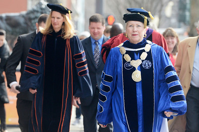 Erica Miller @togianphotog - The Saratogian:  in Saratoga Springs, everyone was in their college robs for the procession down Broadway for the inauguration of Merodie A. Hancock, Ph.D., as the fourth President of Empire State College. SUNY Chancellor Nancy L. Zimpher robbed walking down Broadway.