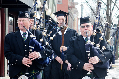 """Erica Miller @togianphotog - The Saratogian:  At the Saratoga Springs City Hall's Music Hall, robbing took place before the procession down Broadway for the inauguration of Merodie A. Hancock, Ph.D., as the fourth President of Empire State College. The 97th old Schenectady Pipe Band performed """"When the Battle O're"""" and """"Green Hills of Tyroll"""" was they led the procession. Tom McElroy, '96, was the mace bearer leading the parade."""