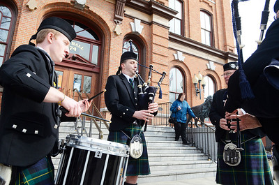 """Erica Miller @togianphotog - The Saratogian:  At the Saratoga Springs City Hall's Music Hall, robbing took place before the procession down Broadway for the inauguration of Merodie A. Hancock, Ph.D., as the fourth President of Empire State College. The 97th old Schenectady Pipe Band performed """"When the Battle O're"""" and """"Green Hills of Tyroll"""" was they led the procession."""
