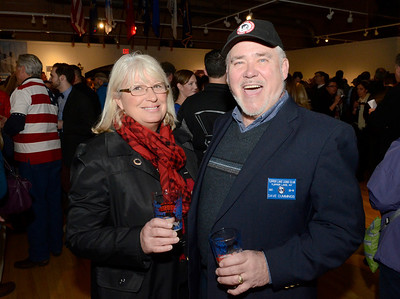 Ed Burke - The Saratogian 03/28/14 Wearing his badge from when he was a member of the Tupper Lake Lions Club in the 1980s, Dave Cummings and Michele Moffitt attend Friday's Night at The Brewseum fundraiser at the New York State Military Museum. The event was sponsored by Friends of the New York State Museum and the Saratoga Lions Club.