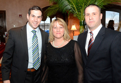 Ed Burke - The Saratogian 03/22/14 Board member David Martin, left, with Director Michelle Smith and board president Mike Mihaly at Saturday's Treasure Island Birthday Bash fundraiser for the Children's Museum at Saratoga National Golf Club.
