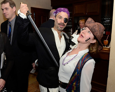Ed Burke - The Saratogian 03/22/14 Supporters Johnny and Diane Martinez dress and play the part during Saturday's Treasure Island Birthday Bash fundraiser for the Children's Museum at Saratoga National Golf Club.