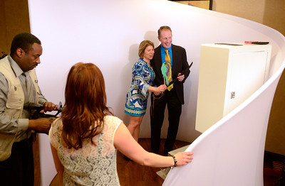 Ed Burke - The Saratogian 03/22/14 Board member Beth Gelber and Jeff Farbaniec have their picture taken in a photo booth at Saturday's Treasure Island Birthday Bash fundraiser for the Children's Museum at Saratoga National Golf Club.