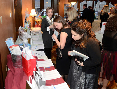 Ed Burke - The Saratogian 03/22/14 Supporters consider bidding on silent auction items at Saturday's Treasure Island Birthday Bash fundraiser for the Children's Museum at Saratoga National Golf Club.