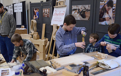 Ed Burke - The Saratogian 03/29/14 Youths at the Greenwich-based Maplewood Center for Common Craft booth work on projects Saturday at the Northeast Woodworkers Association's Showcase at the Saratoga Springs City Center. From left are Isaac Ashdown, Ian Macica, Simeon Ashdown and Josiah Macica. The show continues Sunday.