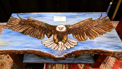 Ed Burke - The Saratogian 03/29/14 A wood-burnt bald eagle swoops from a custom table made by Elizabeth Drambour of Saratoga Springs at the Northeast Woodworkers Association's Showcase at the Saratoga Springs City Center. The show continues Sunday.