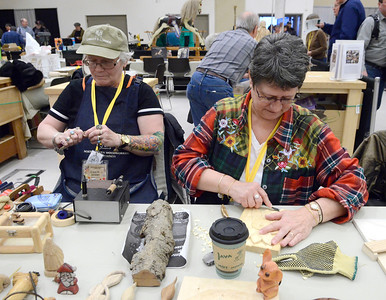 Ed Burke - The Saratogian 03/29/14 Members of the Milton-based Wood Butchers, Carol Ayers, left, and Claudia Brownell carve Saturday at the Northeast Woodworkers Association's Showcase at the Saratoga Springs City Center. The show continues Sunday.