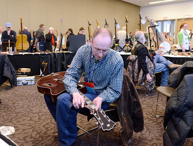 Ed Burke - The Saratogian 03/29/14 Luthier Marty Macica of Schuylerville strings an acoustic guitar he finished building Saturday at 5:30 a.m. at the Northeast Woodworkers Association's Showcase at the Saratoga Springs City Center. The show continues Sunday.