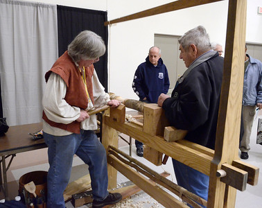 Ed Burke - The Saratogian 03/29/14 A machine first documented in the 1500s, Dave Nilson of Galway uses a foot-powered spring pole lathe Saturday at the Northeast Woodworkers Association's Showcase at the Saratoga Springs City Center. The show continues Sunday.