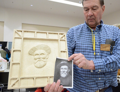 Ed Burke - The Saratogian 03/29/14 Al Doty of Ballston Lake displays a carving he was working on of Adirondack hermit and guide French Louie at the Northeast Woodworkers Association's Showcase at the Saratoga Springs City Center. The show continues Sunday.