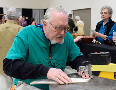 Ed Burke - The Saratogian 03/29/14 Patrick Cummings of Schenectady uses a scroll saw to carve wood at the Northeast Woodworkers Association's Showcase at the Saratoga Springs City Center. The show continues Sunday.