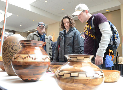 Ed Burke - The Saratogian 03/29/14 Marissa Mackay and Adam Taylor of Wilton admire handmade bowls at the Northeast Woodworkers Association's Showcase at the Saratoga Springs City Center. The show continues Sunday.