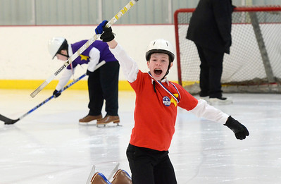 Ed Burke - The Saratogian 03/29/14 Thirteen year old William Richmond of Hudson Falls celebrates his goal during the Saratoga Ice Stars program Saturday at Saratoga Springs Ice Rink. The program, which is over 15 years old, is run by the Saratoga Springs Lions Club and gets physically challenged youths and adults on the ice to enjoy skating.