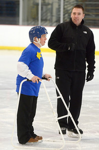 Ed Burke - The Saratogian 03/29/14 Ice Star Brian DeMowpied of Malta skates with volunteer kyle Manny during the Saratoga Ice Stars program Saturday at Saratoga Springs Ice Rink. The program, which is over 15 years old, is run by the Saratoga Springs Lions Club and gets physically challenged youths and adults on the ice to enjoy skating.