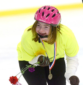 Ed Burke - The Saratogian 03/29/14 Lea Constantino of Saratoga Springs shares a laugh with friends during the Saratoga Ice Stars program Saturday at Saratoga Springs Ice Rink. The program, which is over 15 years old, is run by the Saratoga Springs Lions Club and gets physically challenged youths and adults on the ice to enjoy skating.