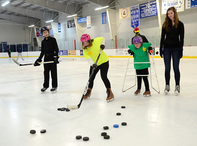 Ed Burke - The Saratogian 03/29/14 Lea Constantino of Saratoga Springs fires a dozen pucks at once  during the Saratoga Ice Stars program Saturday at Saratoga Springs Ice Rink. The program, which is over 15 years old, is run by the Saratoga Springs Lions Club and gets physically challenged youths and adults on the ice to enjoy skating.