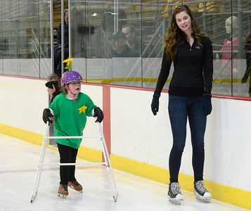 Ed Burke - The Saratogian 03/29/14 Spring has sprung from the helmet of Tegan Klingenberg as she skates with volunteer Lexi Shannon during the Saratoga Ice Stars program Saturday at Saratoga Springs Ice Rink. The program, which is over 15 years old, is run by the Saratoga Springs Lions Club and gets physically challenged youths and adults on the ice to enjoy skating.
