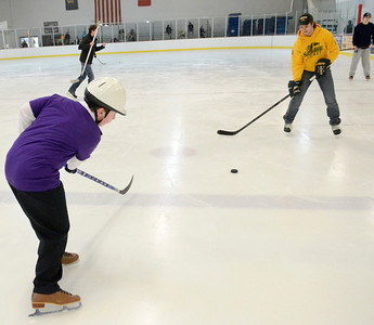 Ed Burke - The Saratogian 03/29/14 Eleven year old Noah Richmond of Hudson Falls passes a puck back and forth with Skidmore College hockey player Brad Schuler during the Saratoga Ice Stars program Saturday at Saratoga Springs Ice Rink. The program, which is over 15 years old, is run by the Saratoga Springs Lions Club and gets physically challenged youths and adults on the ice to enjoy skating.