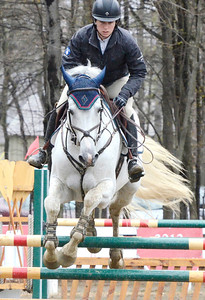 Pegasus-like flight carries Udento VDL and rider Julie Welles of Warren, Vermont over a jump during opening day of the Saratoga Springs Horse Show on Union Ave.