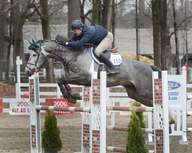 Ed Burke - The Saratogian 04/30/14 Tim Hooker of Lake George and Blockley clear a hurdle Wednesday during the Saratoga Springs Horse Show on Union Ave.