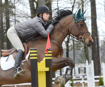 Ed Burke - The Saratogian 04/30/14 Juliana Starbuck of Connecticut takes Contego 2 over a fence during opening day of the Saratoga Springs Horse Show on Union Ave.