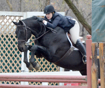 Ed Burke - The Saratogian 04/30/14 Leslie Miller of Sandy Hook, Connecticut jumps Cinderella man during opening day of the Saratoga Springs Horse Show.