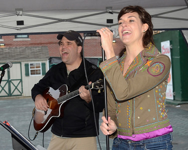 Ed Burke - The Saratogian 04/26/14 Kristen Renehan and Jim Mastrianni perform on Henry St. during Saturday's Tree Toga event.