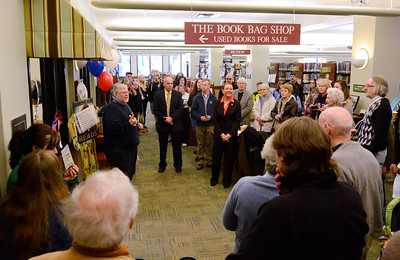 Ed Burke - The Saratogian 04/05/14 Saratoga Springs Public Library Director A. Issac Pulver welcomes guests as Mayor Joanne Yepsen waits to cut the ribbon officially opening The Book Bag used book store which is run by the Friends of SSPL. Ribbon cuttings also happened at the library Saturday for the renovated teen room and the library cafe now run by the nearby Bread Basket Bakery and will open officially later this week.