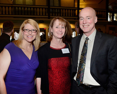 SOS supporters Shelly Amato, left, and Dave Nelson join SOS Board President Lynn Bradley during Thursday's Shelters of Saratoga gala at Longfellows Restaurant.
