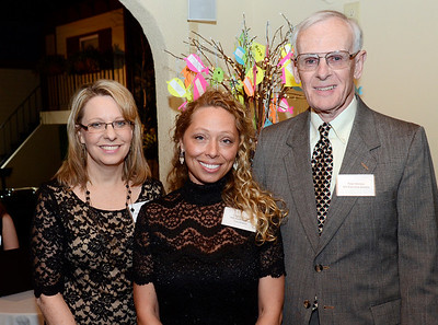 Ed Burke - The Saratogian 04/03/14 Shelters of Saratoga officials attending Thursday's gala at Longfellows from left are Director of Marketing and Development Cindy Harrington, Youth Outreach Coordinator Crystal Swinton and Executive Director Peter Whitten.