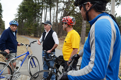 Erica Miller @togianphotog - The Saratogian:  On Friday afternoon, April 11th, 2014, in Saratoga Springs Pete Goutos speaks with his puppy Junior surrounded by Wally Elton (left), Dan Lynch (right) and Jeff Olson (farthest right). The were standing on the State Park Trail.