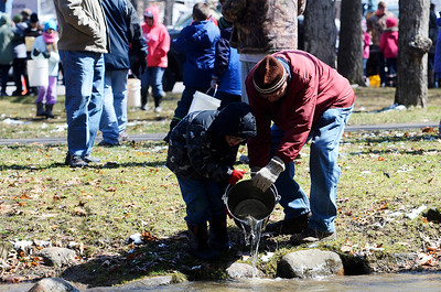 Erica Miller @togianphotog - The Saratogian:  On Wednesday morning, April 16th 2014, the hundreds lined-up the Van Hornesville Fish Hatchery, operated by the Department of Environmental Conservation, stocked the Geyser Creek with trouts at the Saratoga Spa State Park. Children arrived with their buckets in hand to drop their own trout.