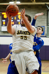 Erica Miller - The Saratogian @togianphotog      The Saratoga Central Catholic Saint's Keegan Murphy up for a shot during their basketball game against Mayfield on Monday evening on January 13th, 2014.