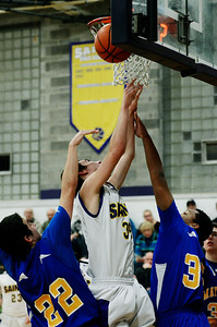 Erica Miller - The Saratogian @togianphotog      The Saratoga Central Catholic Saint's Even Pescetti takes a shot with the ball during their basketball game against Mayfield on Monday evening on January 13th, 2014.