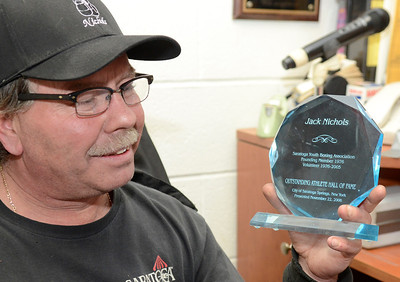 Ed Burke - The Saratogian 01/22/14 Mike Nichols holds an award presented to his father Jack in 2006 by the City of Saratoga Springs.