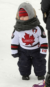 Ed Burke - The Saratogian 01/25/14 Fifteen month old Liam Traynor of Saratoga Springs watches the action Saturday during the Saratoga Frozen Springs Classic Hockey Tournament at Saratoga Spa State Park.