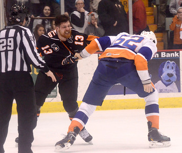 Ed Burke - The Saratogian 04/18/14 Adirondack's Zack FitzGerald mixes it up with Bridgeport's Joe Finley during the Phantom's last game in Glens Falls Friday evening.