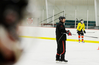 Erica Miller @togianphoto - The Saratogian, The Rivermen Ice Hockey team practiced on Monday, Jan. 13th, 2014, afternoon at the Glens Falls Rec Center. Head coach Mike Di Fiore during practice as they get ready for their next game. The team consists students from South Glens Falls, Glens Falls and Hudson Falls.