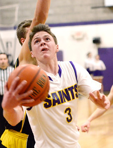 Ed Burke - The Saratogian 01/17/14 Saratoga Central Catholic's Luke Spicer goes to the basket during Friday's varsity basketball matchup against Canajoharie in Saratoga.