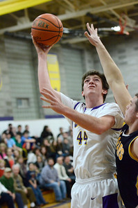 Ed Burke - The Saratogian 01/17/14 Saratoga Central Catholic's Mike Naughton tries for two  as Canajoharie's Zach Folts tries to block during Friday's varsity basketball matchup in Saratoga.