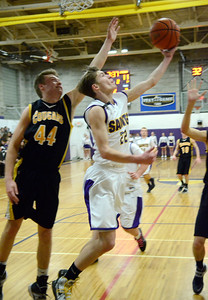 Ed Burke - The Saratogian 01/17/14 Saratoga Central Catholic's Ryan Czarnecki underhands two for the Saints as Canajoharie's Josh Gonzalez tries to block during Friday's varsity basketball matchup in Saratoga.