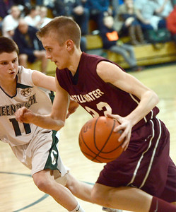 Ed Burke - The Saratogian 01/21/14 Stillwater's Mitch Wayand dribbles past Greenwich defender Sean Estramonte during Tuesday's matchup at Greenwich.