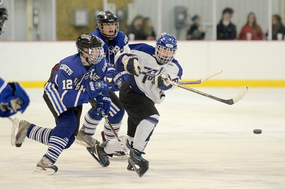 Ed Burke - The Saratogian 01/22/14 Saratoga's Colin Paton passes the puck pressured by La Salle's Ben Gardenier at left during Wednesday's game in Saratoga.